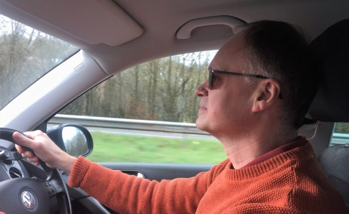 John England driving guests on a tour